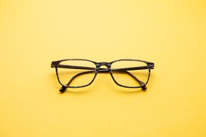 graduated glasses on yellow backgrou