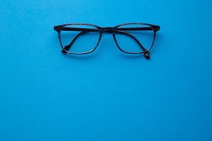 graduated glasses on blue background
