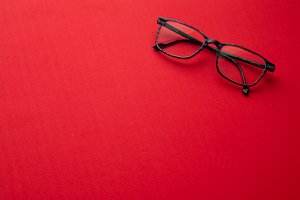 graduated glasses on red background