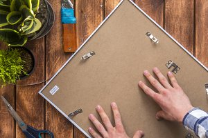 top down photo frame with hands on top