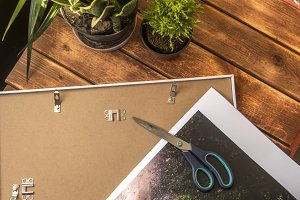 photo lying on a frame on a wooden surface