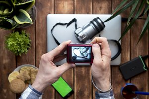 top down photographer making photoes using compact camera at home