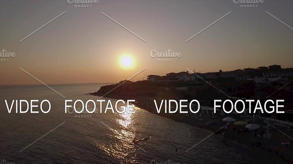 Sunset Scene Of Resort And Sea With Boats Aerial Trikorfo Beach In Greece
