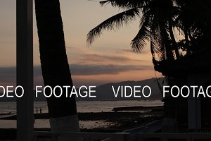 Sunrise over tropical island beach and palm trees, Bali island.