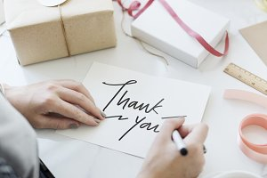 Woman writing a Thank You card