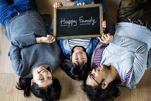 Family holding a phrase Happy Family