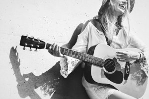 Singer songwriter with her guitar