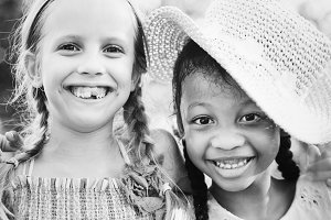 Diverse little girls happy together
