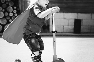 Happy little boy playing superhero
