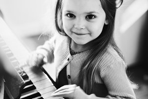 Little Caucasian girl playing piano