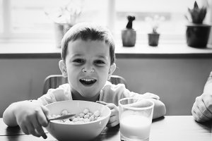 Little boy smiling while eating