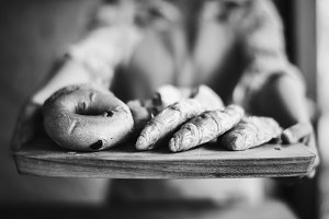 Closeup of hands holding fresh bread