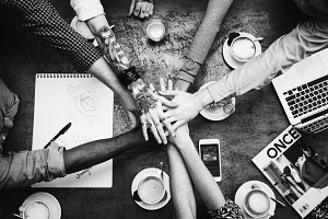 Group of friends stacking hands