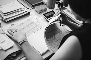 Asian woman working with paperwork