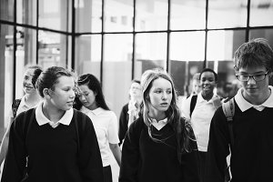 Group of students walking in school