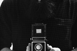 Photographer using a vintage camera