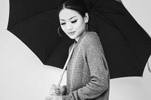 Asian woman holing umbrella