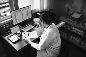 Female doctor studying a case