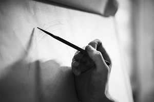People drawing portraits by pencil