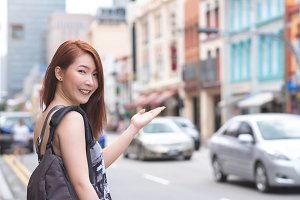 Young woman travel in Singapore
