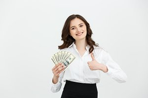 Beautiful young business woman with dollar bills on white background