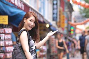 Young woman travel in China town