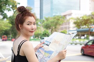 Young woman holding map