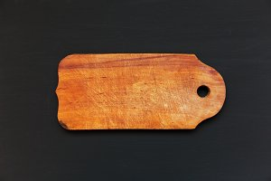 Old cutting board on dark background