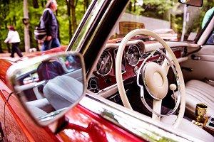 Close up of veteran car, dashboard, steering wheel, rearview mir
