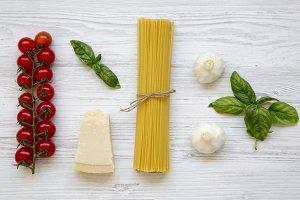 Spaghetti, tomatoes with basil
