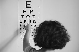 Caucasian girl getting an eye exam