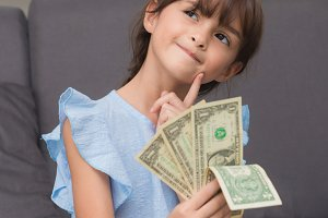 girl showing hundred dollar bills