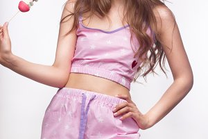 Young fresh girl in pajamas, smile and curls retro style. Beauty face, body.