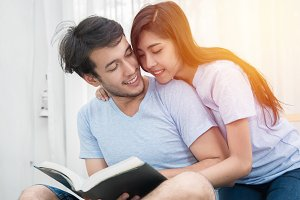 young loving couple reading a book