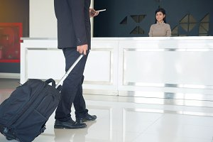 Businessman drag luggage or suitcase