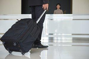 Businessman drag luggage or suitcase
