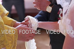 close-up, wedding ceremony in the church, the bride and groom tied hands with a towel