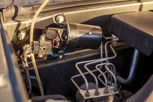 close up car opened hood motor