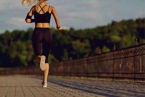 Girl runner jogging in the park in morning  evening