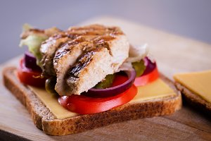 Fresh homemade grilled chicken sandwich on wood