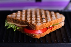 Fresh sandwich baking in a grill