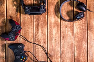 video gaming devices kit on the wooden table copy space