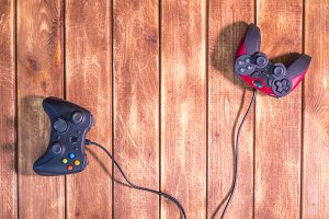 two video game devices on the wooden table with copy space