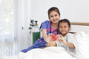Doctor caring with love little girl in hospital