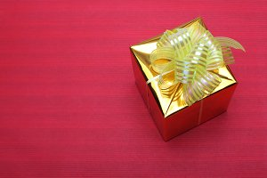 gold gift box on red