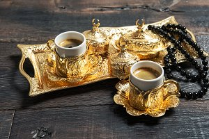 Golden coffee cups rosary