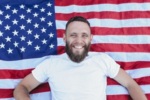 Happy hipster man on USA flag