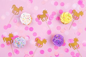 Unicorns and cupcakes background