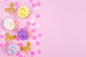 Unicorns and cupcakes with copyspace