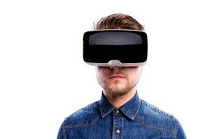 Man wearing virtual reality goggles. Studio shot, white backgrou